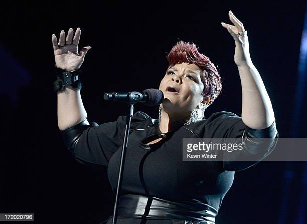 Singer Tamela Mann performs onstage during the 2013 BET Awards at Nokia Theatre LA Live on June 30 2013 in Los Angeles California