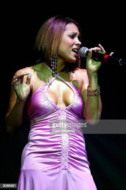 Singer Tamia performs onstage during the second stop on the Verizon Ladies First Tour 2004 on March 14 2004 at the New Orleans Arena in New Orleans...