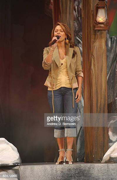 Singer Tamia performs the Canadian National Anthem before the 54th AllStar Game part of 2005 NBA AllStar Weekend at Pepsi Center on February 20 2005...