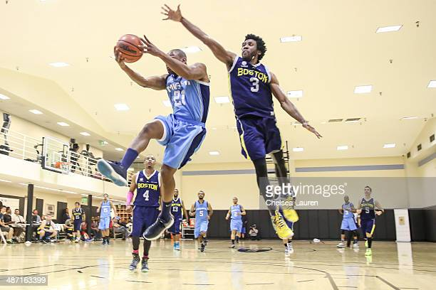 Singer Tank and actor Nyambi Nyambi play in the ELeague celebrity basketball playoffs at Equinox Sports Club West LA on April 27 2014 in Los Angeles...