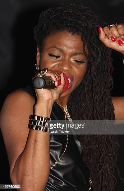 Singer Tash Lorayne performs at The Single Launch Celebration for hit reggae artist AMMOYE at Remix Lounge on September 19 2014 in Toronto Canada