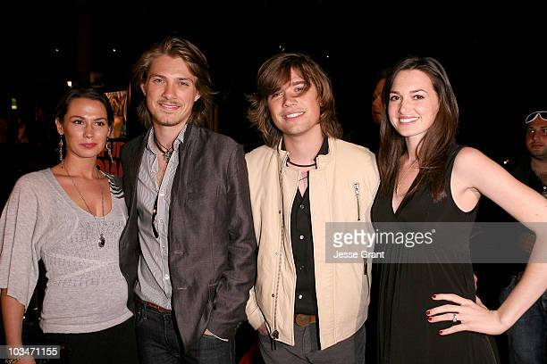 Singer Taylor Hanson and wife Natalie and singer Zac Hanson and wife Kate arrive at the Darfur Now Los Angeles screening at the Directors Guild of...