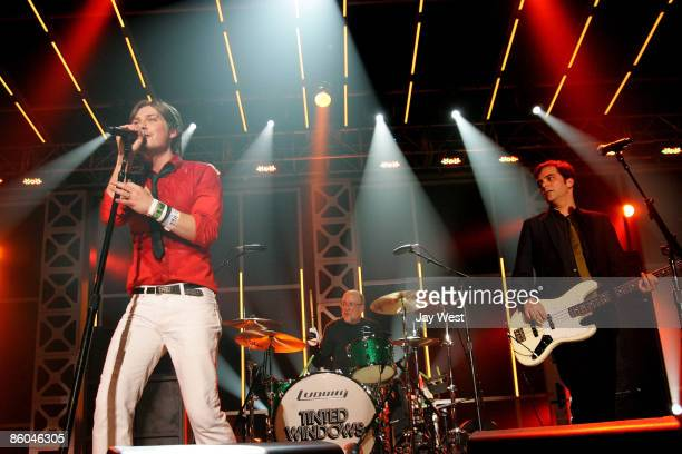 Singer Taylor Hanson Drummer Bun E Carlos and Bass player Adam Schlesinger of the new band Tinted Windows perform in concert on day 4 of the 2009...
