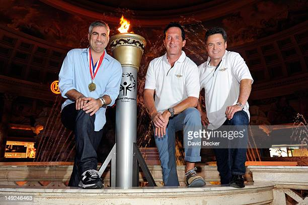 Singer Taylor Hicks, hypnotist Anthony Cools and entertainer Donny Osmond appear after a ceremonial torch relay at The Forum Shops at Caesars on July...