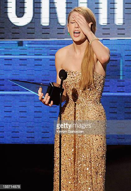 Singer Taylor Swift accepts Favorite Country Album award onstage at the 2011 American Music Awards held at Nokia Theatre L.A. LIVE on November 20,...