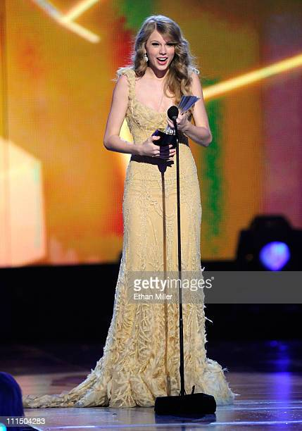 Singer Taylor Swift accepts the Entertainer of the Year Award onstage at the 46th Annual Academy Of Country Music Awards held at the MGM Grand Garden...