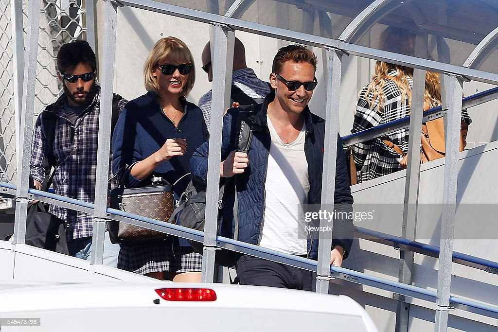 Singer Taylor Swift and actor Tom Hiddleston disembark their plane at Gold Coast Airport in Coolangatta, Queensland.