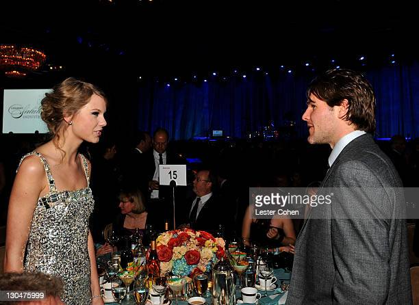 Singer Taylor Swift and athlete Mike Fisher attends the 52nd Annual GRAMMY Awards Salute To Icons Honoring Doug Morris held at The Beverly Hilton...
