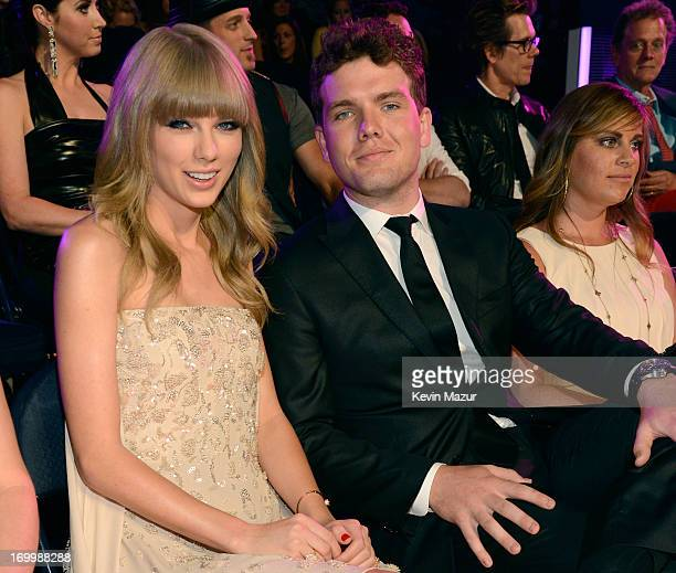 Singer Taylor Swift and Austin Swift attend the 2013 CMT Music awards at the Bridgestone Arena on June 5 2013 in Nashville Tennessee