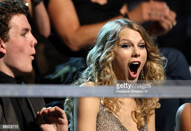 Singer Taylor Swift and Austin Swift react after winning an award during the 2009 CMT Music Awards at the Sommet Center on June 16 2009 in Nashville...