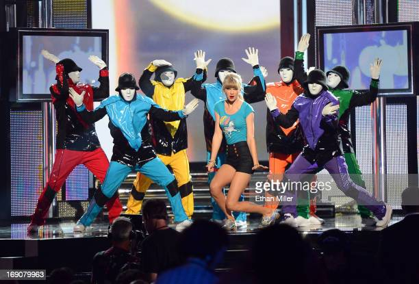 Singer Taylor Swift and members of the Jabbawockeez dance crew perform during the 2013 Billboard Music Awards at the MGM Grand Garden Arena on May 19...