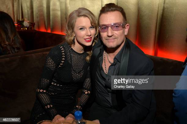Singer Taylor Swift and musician Bono attend The Weinstein Company Netflix's 2014 Golden Globes After Party presented by Bombardier FIJI Water Lexus...