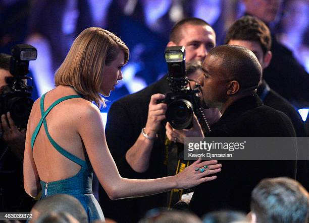 Singer Taylor Swift and rapper Kanye West attend The 57th Annual GRAMMY Awards at the at the STAPLES Center on February 8 2015 in Los Angeles...