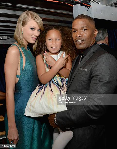 Singer Taylor Swift Annalise Bishop and actor Jamie Foxx attend The 57th Annual GRAMMY Awards at STAPLES Center on February 8 2015 in Los Angeles...