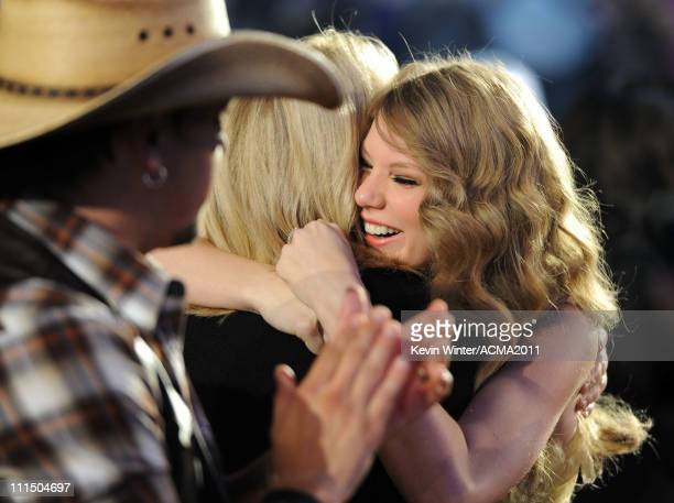 Singer Taylor Swift celebrates in the audience after winning the award for Entertainer of the Year during the 46th Annual Academy of Country Music...