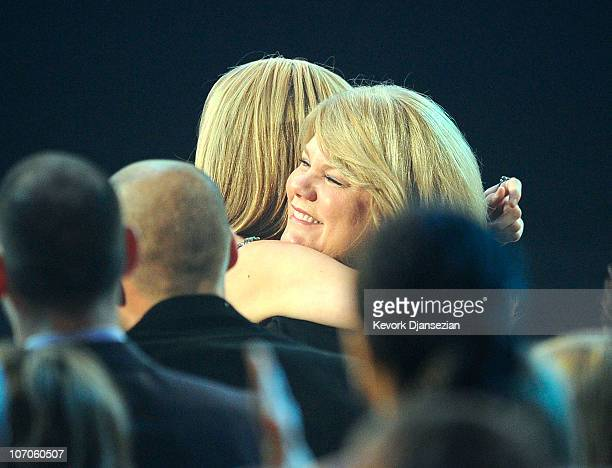 Singer Taylor Swift embraces her mother onstage during the 2010 American Music Awards held at Nokia Theatre LA Live on November 21 2010 in Los...
