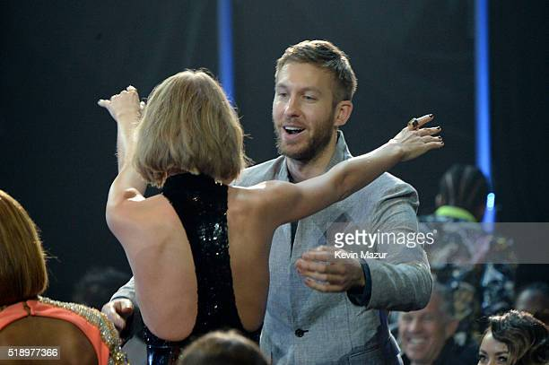 Singer Taylor Swift embraces recording artist Calvin Harris onstage at the iHeartRadio Music Awards which broadcasted live on TBS TNT AND TRUTV from...