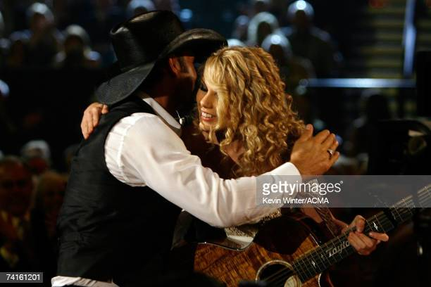 Singer Taylor Swift greets singer Tim McGraw after performing her song titled Tim McGraw onstage during the 42nd Annual Academy Of Country Music...