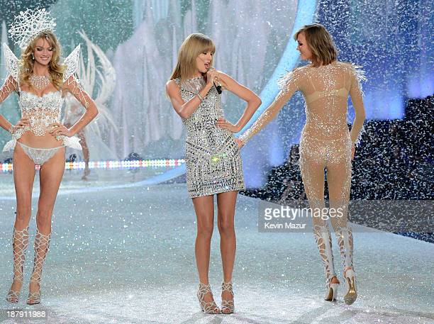 Singer Taylor Swift performs and models Lindsay Ellingson and Karlie Kloss walk the runway at the 2013 Victoria's Secret Fashion Show at Lexington...