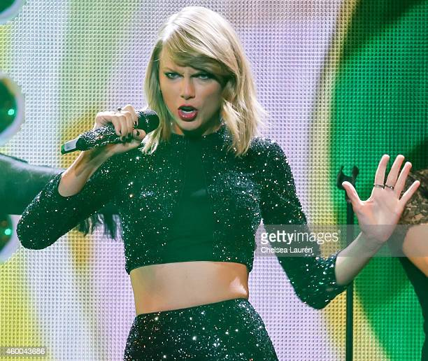 Singer Taylor Swift performs at KIIS FM's Jingle Ball at Staples Center on December 5 2014 in Los Angeles California