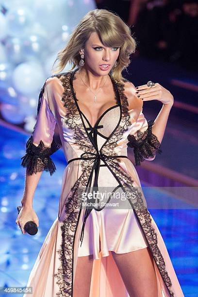 Singer Taylor Swift performs at the annual Victoria's Secret fashion show at Earls Court on December 2 2014 in London England