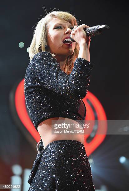 Singer Taylor Swift performs onstage during KIIS FM's Jingle Ball 2014 powered by LINE at Staples Center on December 5 2014 in Los Angeles California