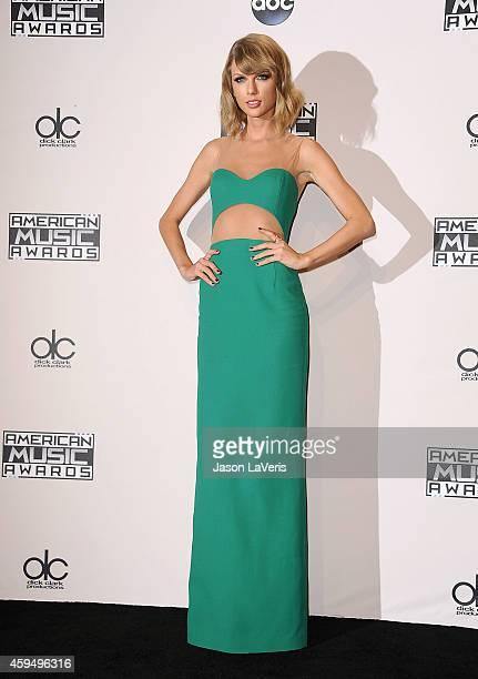Singer Taylor Swift poses in the press room at the 2014 American Music Awards at Nokia Theatre LA Live on November 23 2014 in Los Angeles California