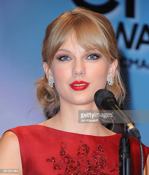 Singer Taylor Swift poses in the press room at the 47th annual CMA Awards at the Bridgestone Arena on November 6 2013 in Nashville Tennessee