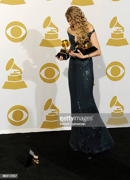 Singer Taylor Swift poses with Album Of The Year award for 'Fearless' Best Female Country Vocal Performance for 'White Horse' Best Country Song for...