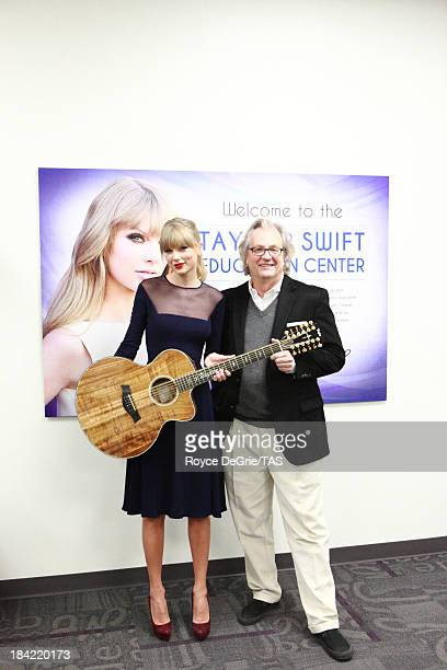Singer Taylor Swift poses with one of her very first12 string guitars and with Museum Director Kyle Young during the Taylor Swift Education Center...