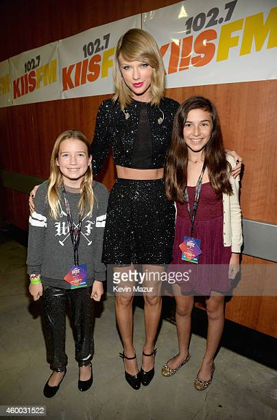 Singer Taylor Swift poses with young fans during KIIS FM's Jingle Ball 2014 powered by LINE at Staples Center on December 5 2014 in Los Angeles...