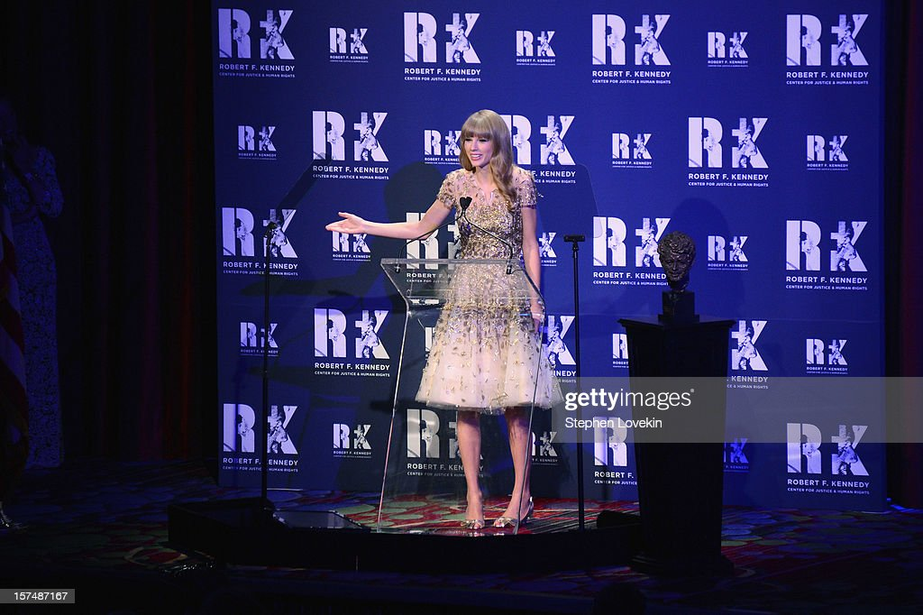 Singer Taylor Swift speaks onstage at the 2012 Ripple Of Hope Gala at The New York Marriott Marquis on December 3, 2012 in New York City.