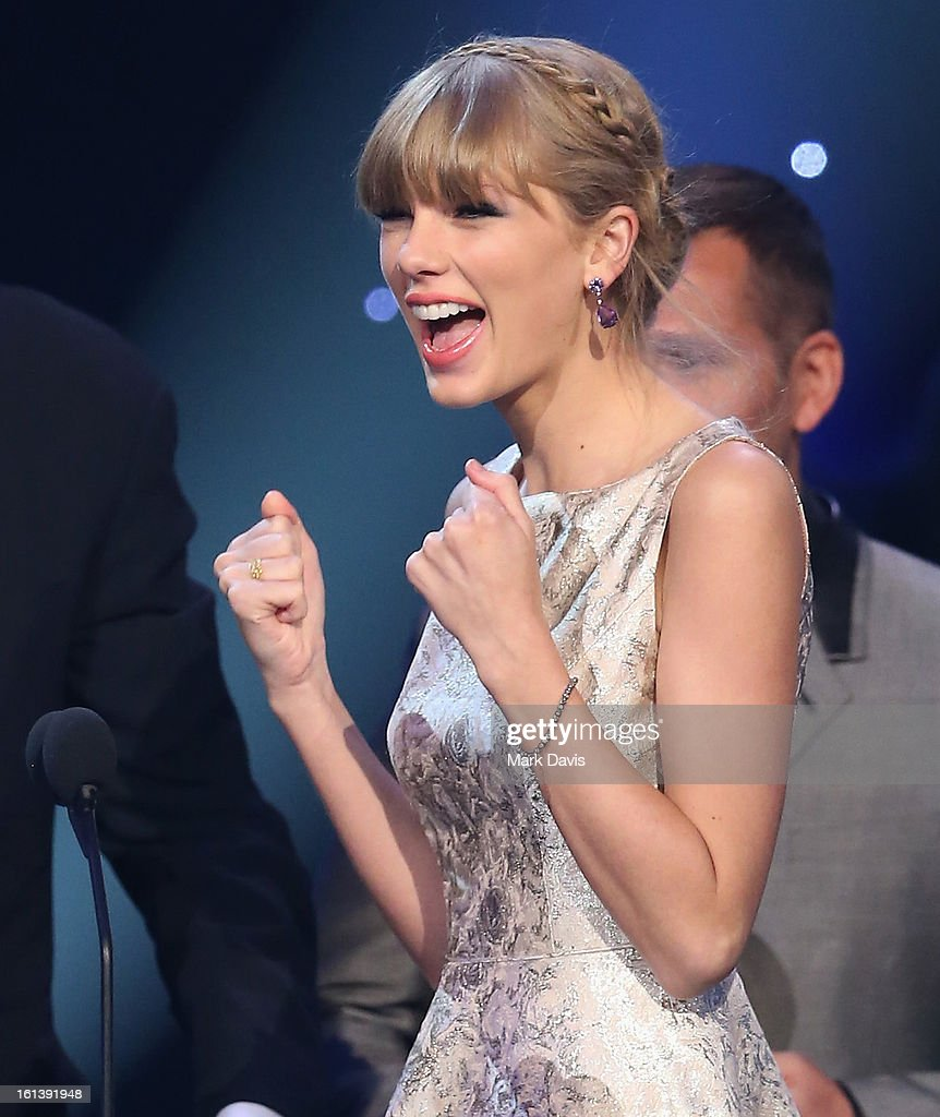 Singer Taylor Swift speaks onstage during the 55th Annual GRAMMY Awards Pre-Telecast at Nokia Theatre L.A. Live on February 10, 2013 in Los Angeles, California.