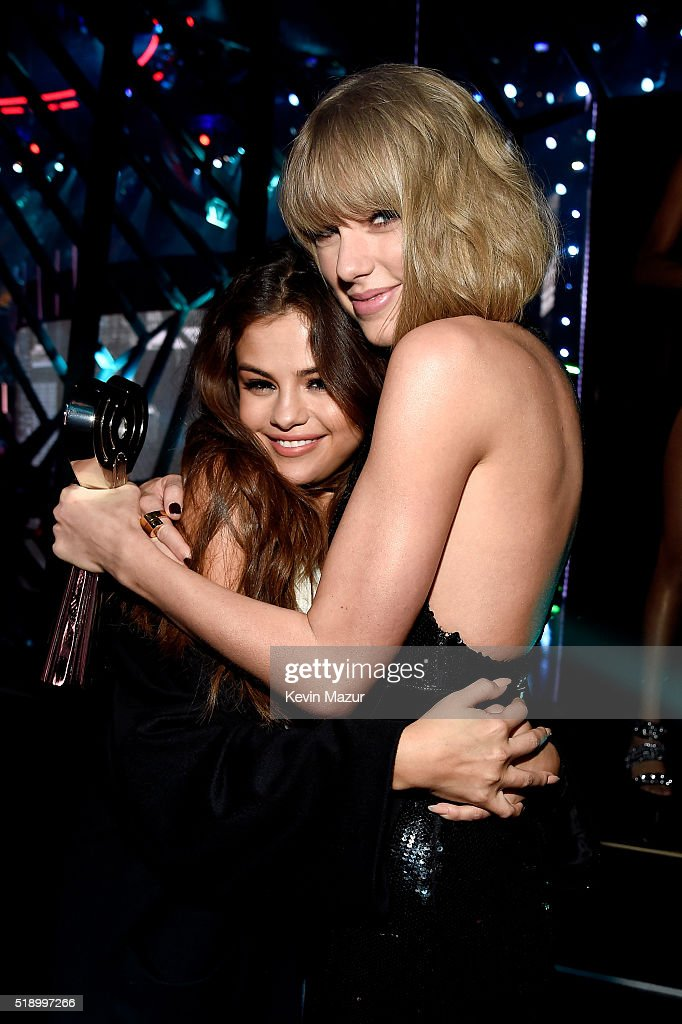 Singer Taylor Swift (R), winner of the Album of the Year award for '1989,' embraces actress/singer Selena Gomez backstage at the iHeartRadio Music Awards which broadcasted live on TBS, TNT, AND TRUTV from The Forum on April 3, 2016 in Inglewood, California.