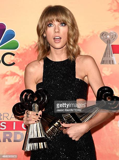 Singer Taylor Swift winner of the awards for Artist of the Year Song of the Year and Best Lyrics poses in the press room during the 2015 iHeartRadio...