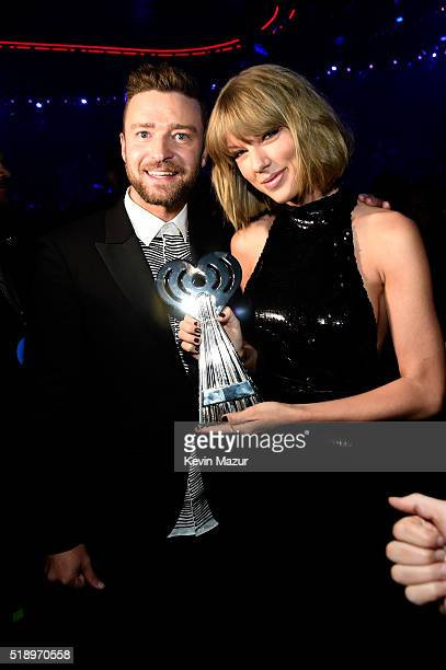 Singer Taylor Swift winner of the Best Tour award and singer Justin Timberlake pose backstage at the iHeartRadio Music Awards which broadcasted live...