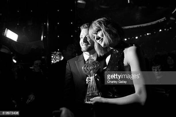 Singer Taylor Swift winner of the Best Tour award and singer Justin Timberlake pose backstage at the iHeartRadio Music Awards at The Forum on April 3...