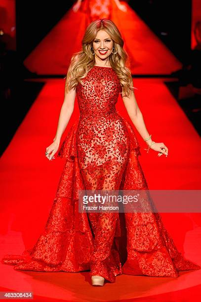 Singer Thalia walks the runway at the Go Red For Women Red Dress Collection 2015 presented by Macy's fashion show during MercedesBenz Fashion Week...