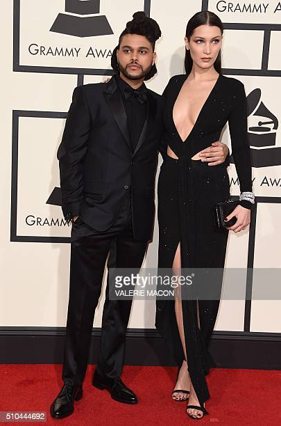 Singer The Weeknd and Bella Hadid arrive on the red carpet for the 58th Annual Grammy music Awards in Los Angeles February 15 2016 AFP PHOTO/ VALERIE...