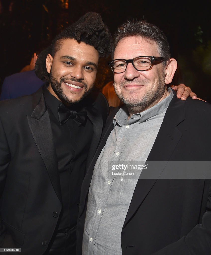 Singer The Weeknd and CBE Chairman & CEO UMG Lucian Grainge attend Universal Music Group 2016 Grammy After Party presented by American Airlines and Citi at The Theatre at Ace Hotel Downtown LA on February 15, 2016 in Los Angeles, California.