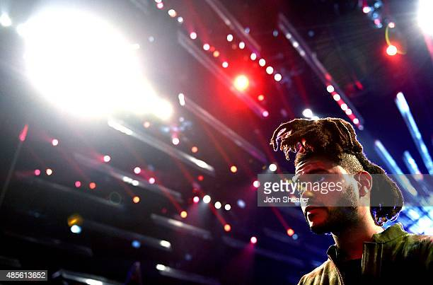 Singer The Weeknd poses during rehearsals for the 2015 MTV Video Music Awards at Microsoft Theater on August 28 2015 in Los Angeles California
