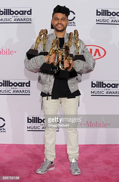 Singer The Weeknd poses in the press room at the 2016 Billboard Music Awards at TMobile Arena on May 22 2016 in Las Vegas Nevada