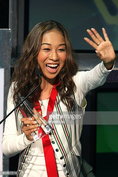 "Singer Thelma Aoyama waves to fans after receiving the Best ""Student Voice"" Love Song award during the MTV Student Voice Awards 2008 at Shinkiba..."