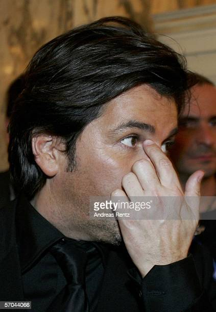 Singer Thomas Anders gestures after the German elimination round for the Eurovision Song contest at the theatre Deutsches Schauspielhaus on March 9,...