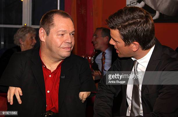 Singer Thomas Quasthoff and host Markus Lanz attend the taping of the birthday show for Bassbaritone singer Thomas Quasthoff on October 15 2009 in...