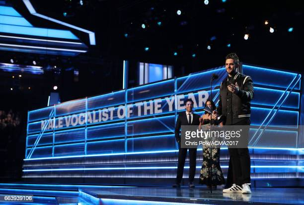 Singer Thomas Rhett accepts the award for Male Vocalist of the Year onstage during the 52nd Academy of Country Music Awards at TMobile Arena on April...