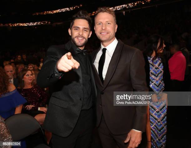 Singer Thomas Rhett and cohost Dierks Bentley attend the 52nd Academy Of Country Music Awards at TMobile Arena on April 2 2017 in Las Vegas Nevada