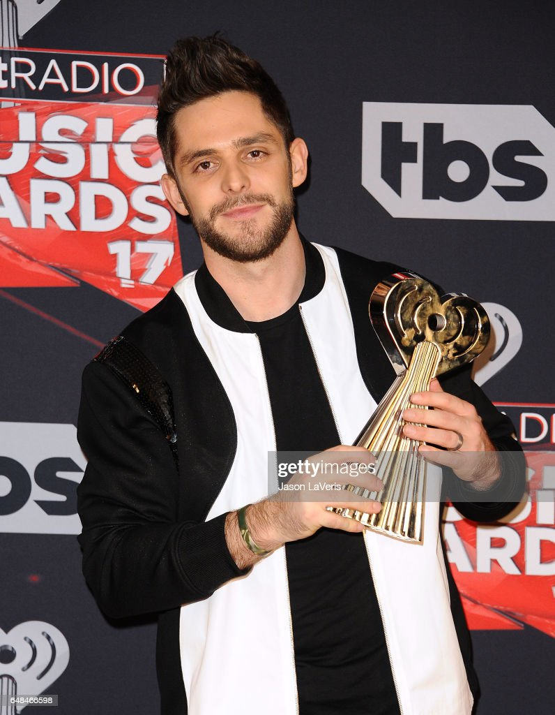 Singer Thomas Rhett poses in the press room at the 2017 iHeartRadio Music Awards at The Forum on March 5, 2017 in Inglewood, California.