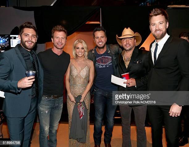 Singer Thomas Rhett singer/cohost Dierks Bentley singer Carrie Underwood singer/cohost Luke Bryan singers Jason Aldean and Charles Kelley pose...