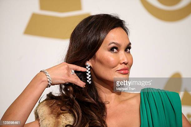 Singer Tia Carrere poses in the press room at The 53rd Annual GRAMMY Awards held at Staples Center on February 13, 2011 in Los Angeles, California.